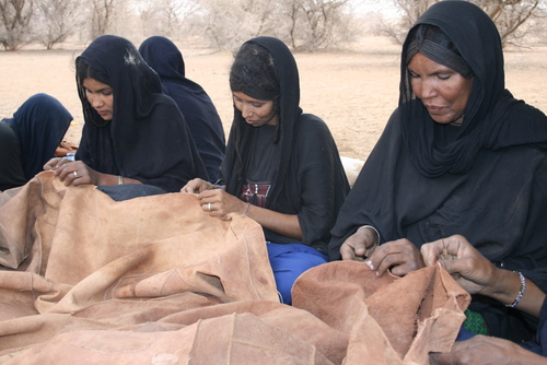 women making tent hide roofs